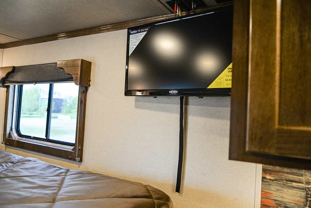 Bedroom TV in a Laramie SLX8FK Horse Trailer | SMC Trailers