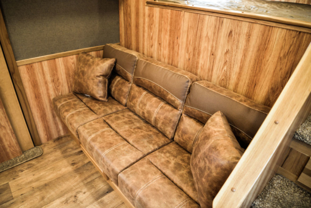 Sofa Bed on the Riser Wall in a SL8X13SSR Laramie Horse Trailers | SMC Trailers