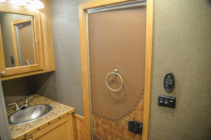 Bathroom is a Barnyard Hickory Interior in a Laramie SL8X11SFK | SMC Horse Trailers