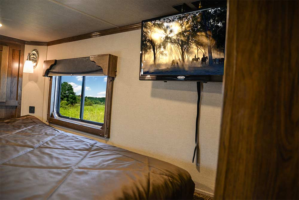 Bedding and Entertainment Area in a SLX10RK Laramie Horse Trailers | SMC Trailers