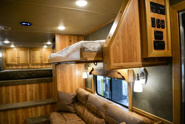Optional flip-down bunk bed in Laramie Livestock SLE8X15DSRK | SMC Trailers