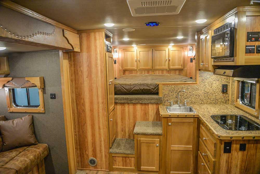 Barnyard Hickory Interior in a Laramie SL8X11SFK | SMC Horse Trailers