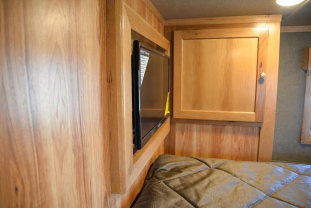 Bedroom TV in a SL8X16BB Laramie Horse Trailer | SMC Trailers
