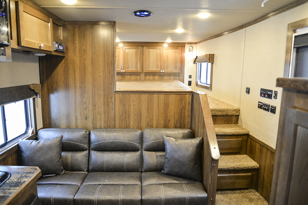 Sofa on the Riser Wall in a SL8X9SR Laramie Horse Trailers | SMC Trailers