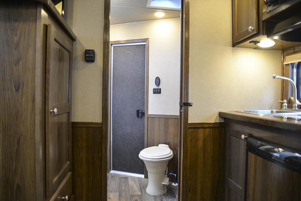 Bathroom Entrance in a SL8X9SR Laramie Horse Trailers | SMC Trailers
