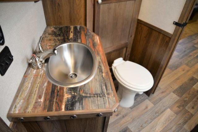 Bathroom in a Laramie SL8X18SBBSRB Horse Trailer | SMC Trailers