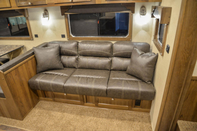 Sofa in Slide-out in LTH8X18SCEB Laramie Edition Livestock | SMC Trailers