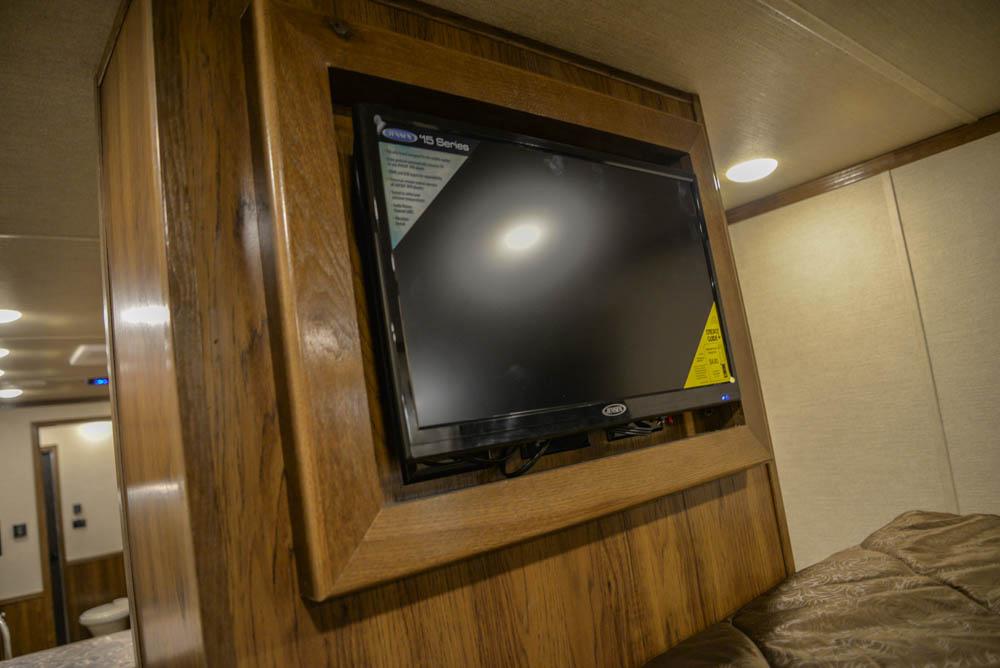 TV in Gooseneck in LTH8X18SCEB Laramie Edition Toy Hauler | SMC Trailers