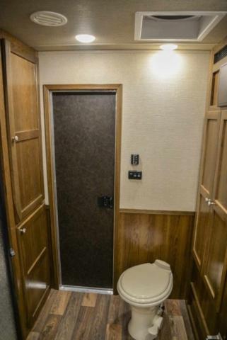 Bathroom in LTH8X18SCEB Laramie Edition Toy Hauler | SMC Trailers