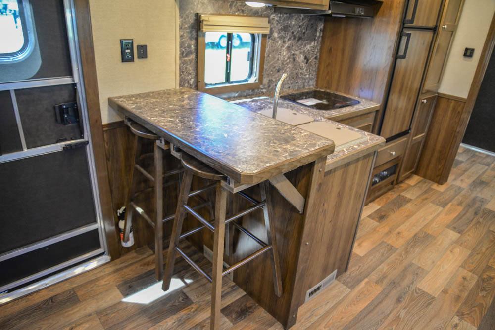 Kitchen Area in LTH8X18SCEB Laramie Edition Toy Hauler | SMC Trailers