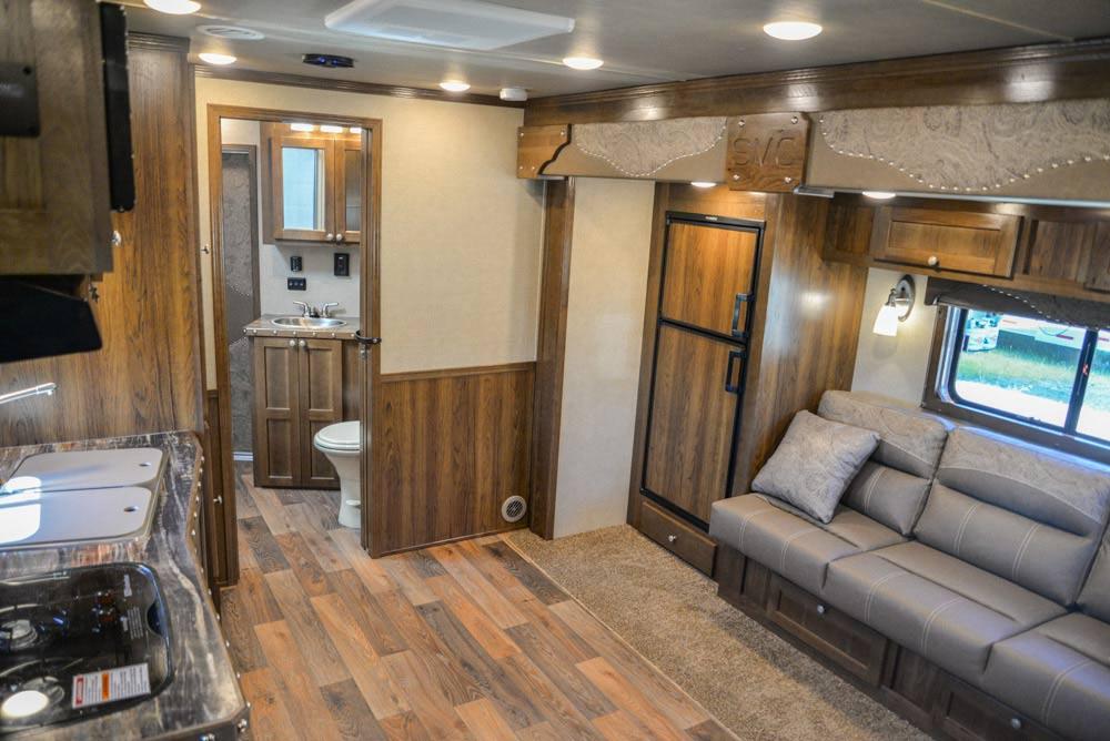 Living Area in a Laramie Livestock SLE8X15SRKCE | SMC Trailers