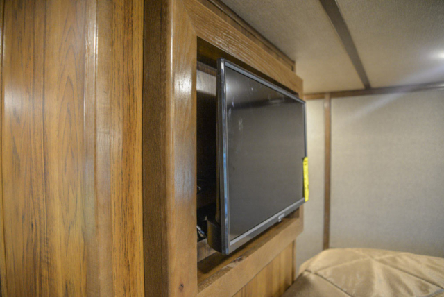 TV in Gooseneck of a Laramie Livestock SLE8X18SCEB | SMC Trailers