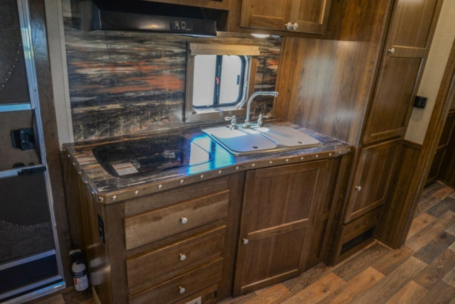 Kitchen Area in a Laramie Livestock SLE8X15SRKCE | SMC Trailers