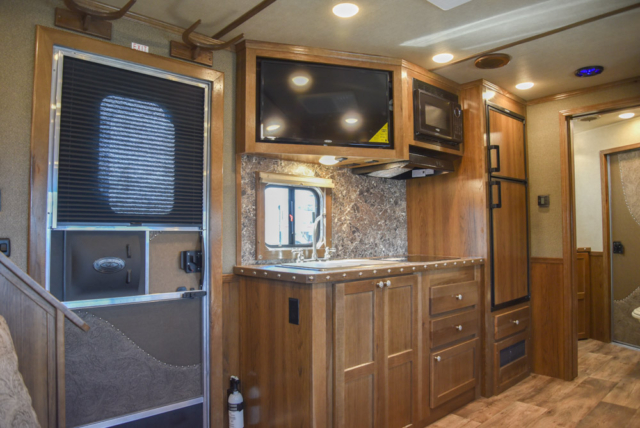 TV and Kitchen in a SL8X14SSR | SMC Trailers