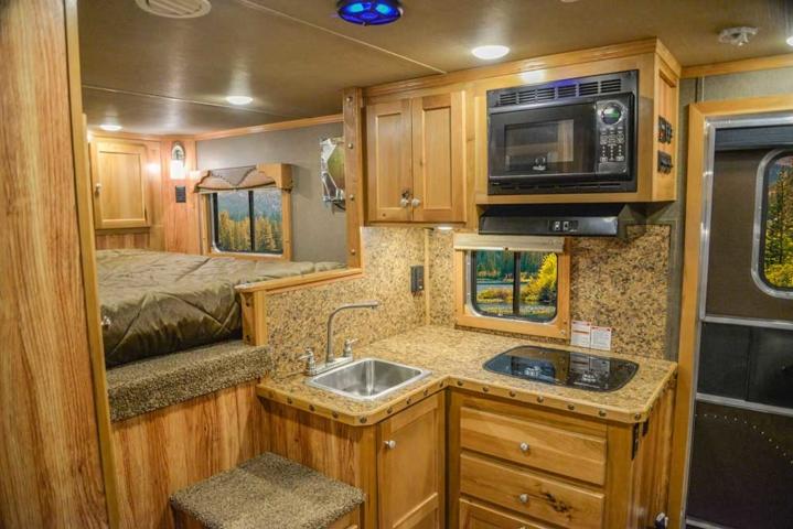 Kitchen in a Farmyard Hickory Interior in a Laramie SL8X11SFK | SMC Horse Trailers