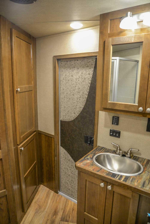 Bathroom Area in a Laramie Livestock SLE8X18SCEB | SMC Trailers
