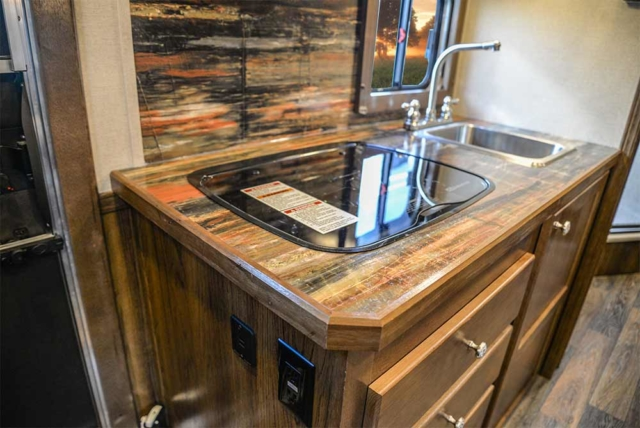 Stove Top and Sink Area / Kitchenette within an SLX10RK Laramie Horse Trailers | SMC Trailers