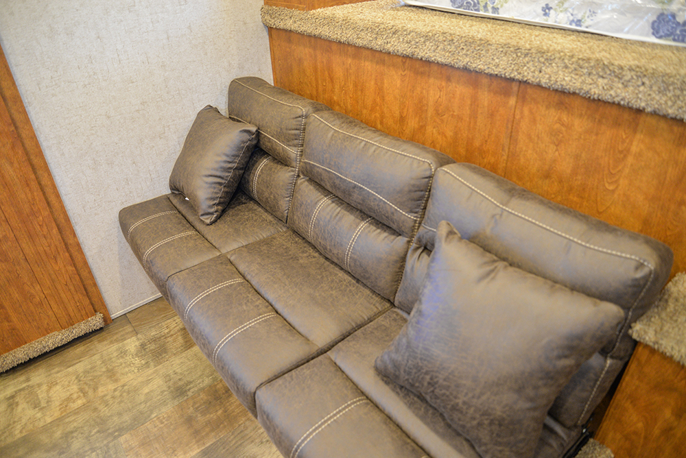 Sofa on riser in Patriot SP8X13SSR | SMC Trailers